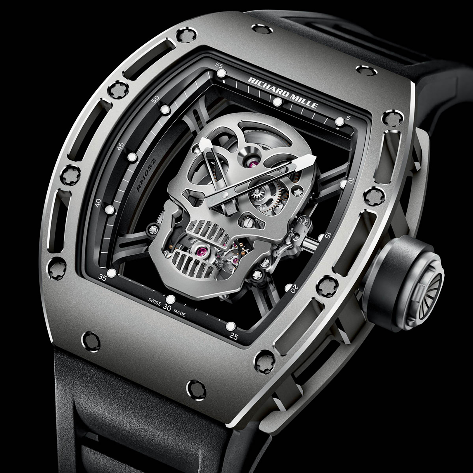 1970229e4f The watch has a skull-shaped base plate made of titanium, with a pair of  crossbones that serve as bridges. Interestingly, the skull has its mouth  slightly ...