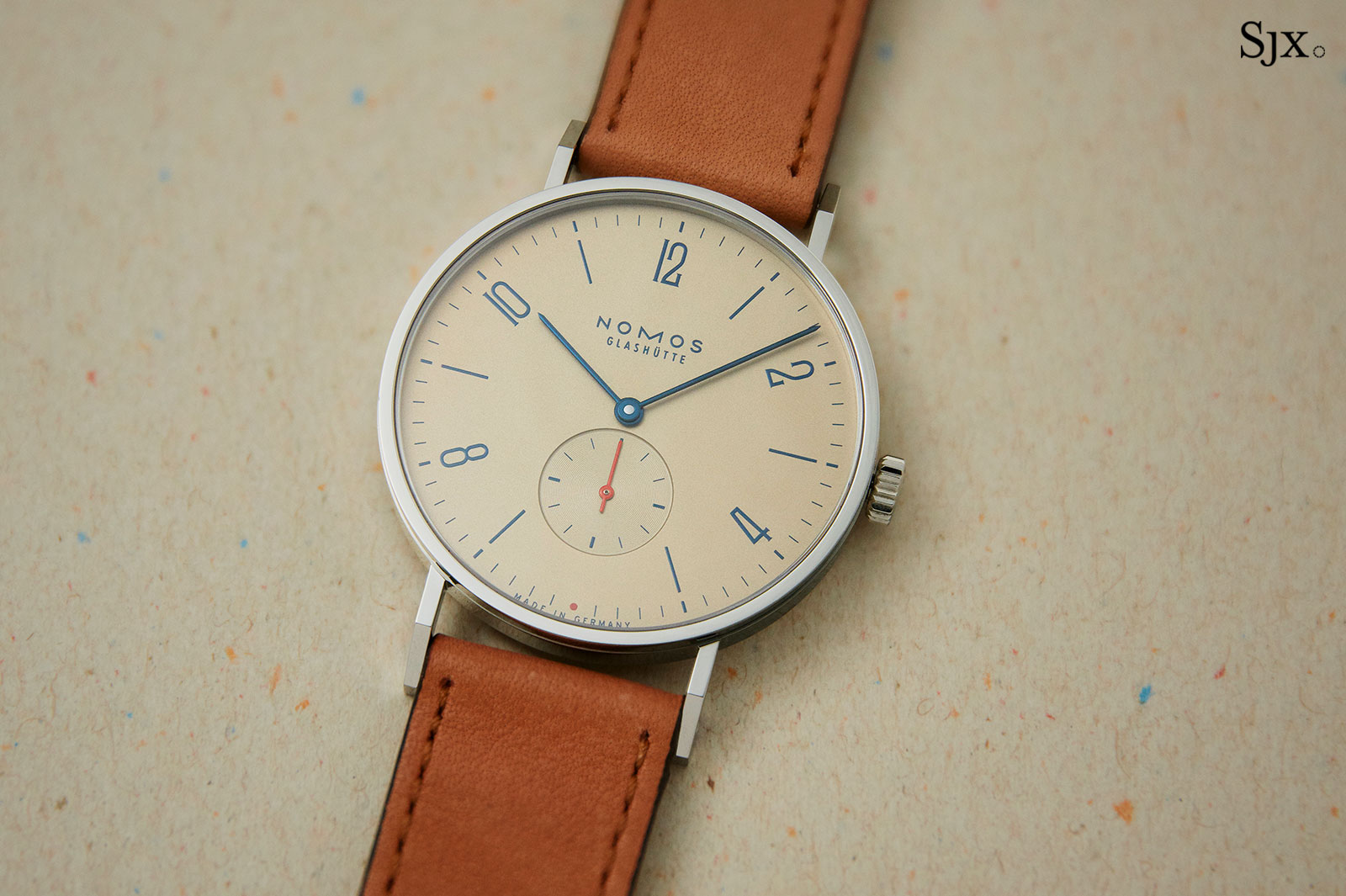 Nomos Tangente Red Dot Singapore salmon 1