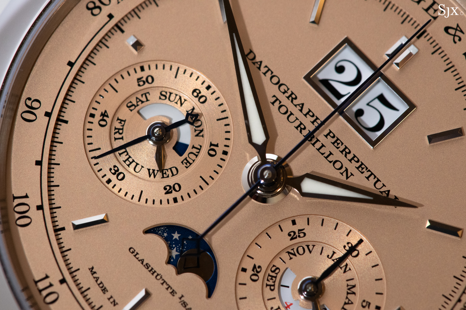 Visible at 6 o'clock is the gold moonphase disc with delicate, laser etched stars.