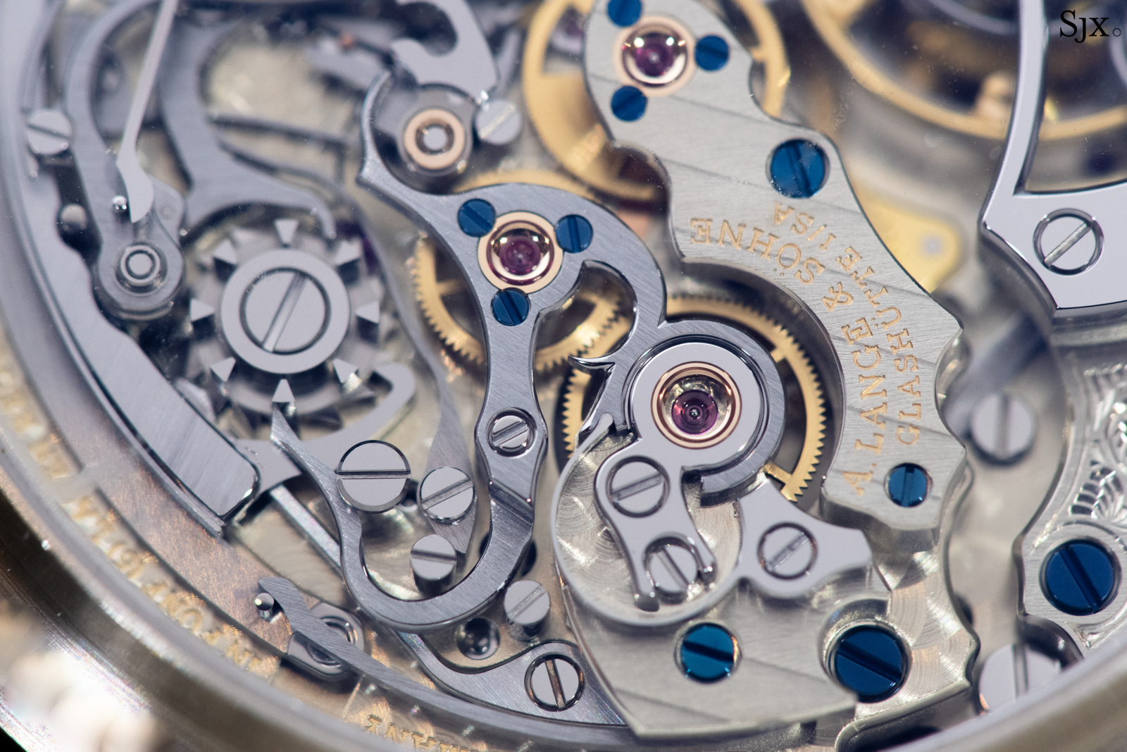 Closeup of the iconic design of the lateral clutch and column wheel. Note the redesigned chronograph bridge to accommodate the tourbillon.